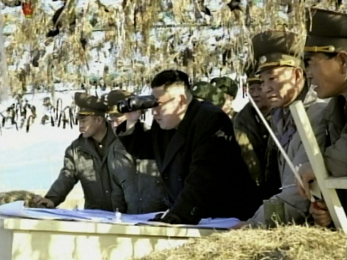 North Korean TV shows Kim Jong-Un looking through binoculars during a trip to an artillery unit on Wolnae Island near the disputed maritime frontier with South Korea. Photo: AFP/NORTH KOREAN TV