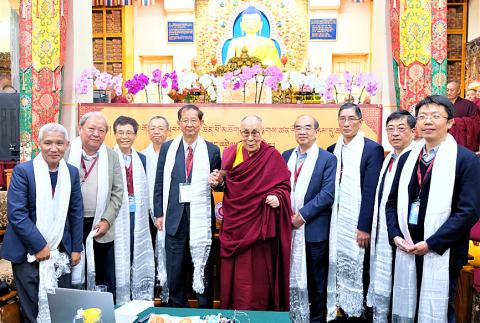 The Dalai Lama in a group photo with the Taiwanese scientists. Photo: Handout