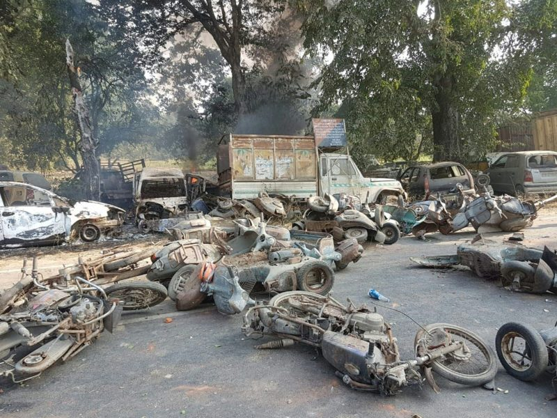 Vehicles smoulder following the violence in Bulandshahr, Uttar Pradesh state. Photo: AFP