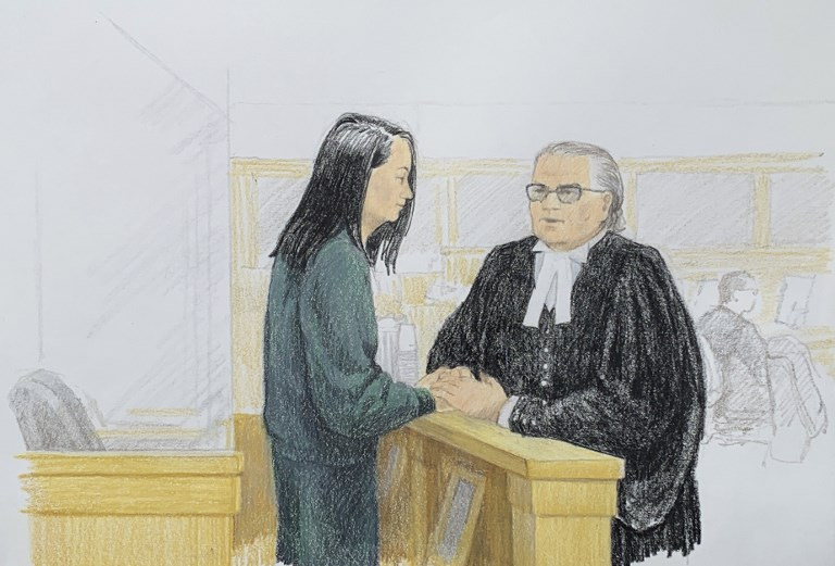 A courtroom sketch of Huawei executive Meng Wanzhou speaking with her lawyer David Martin in the courtroom in Vancouver. Sketch Jane Wolsak via AFP
