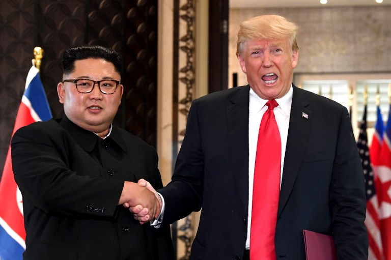 In this file photo taken on June 12, US President Donald Trump (R) and North Korean leader Kim Jong Un shake hands following a signing ceremony during their historic summit in Singapore. Pyongyang on Thursday dashed Trump's hopes for the denuclearization of the Korean Peninsula. Photo: AFP