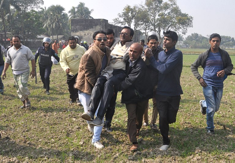BNP candidate Habibur Rahman Habib (C) is rescued by his supporters after an attack during a campaign rally in Ishawardi Upazila, Pabna district, on Wednesday. Photo: AFP