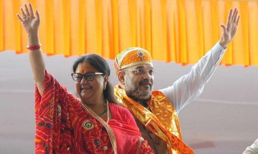 Rajasthan Chief Minister Vasundhara Raje Bharatiya Janata Party State President Amit Shah addresses people at the JK Stadium in Kankroli, Rajsamand in Rajasthan. Photo: AFP/The Times of India/Bhagirath Basnet