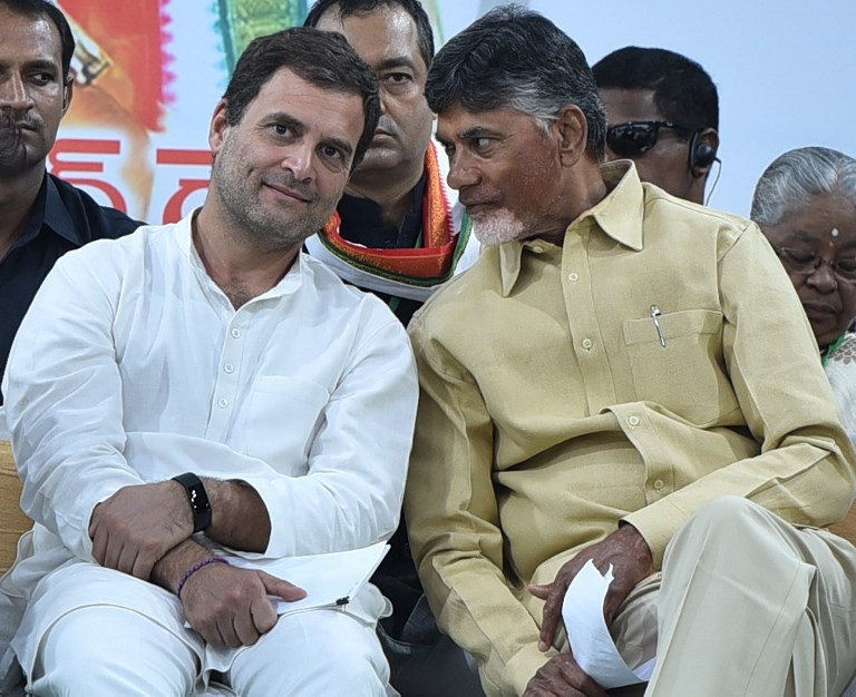 Congress president Rahul Gandhi and Andhra Pradesh Chief Minister N Chandrababu Naidu during an election rally ahead of the state assembly elections in Gadwal, Telangana, on December 03, 2018. Photo: The Times of India/Venkat Rao M/AFP