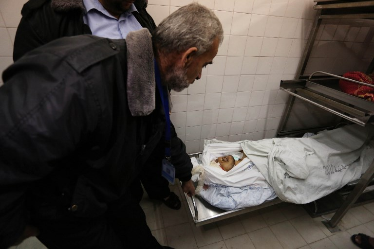 The body of Palestinian Karam Fayyad, 26, who was shot dead by Israeli soldiers during a demonstration, at the morgue of European Gaza Hospital in Khan Yunis on Friday. Photo: AFP