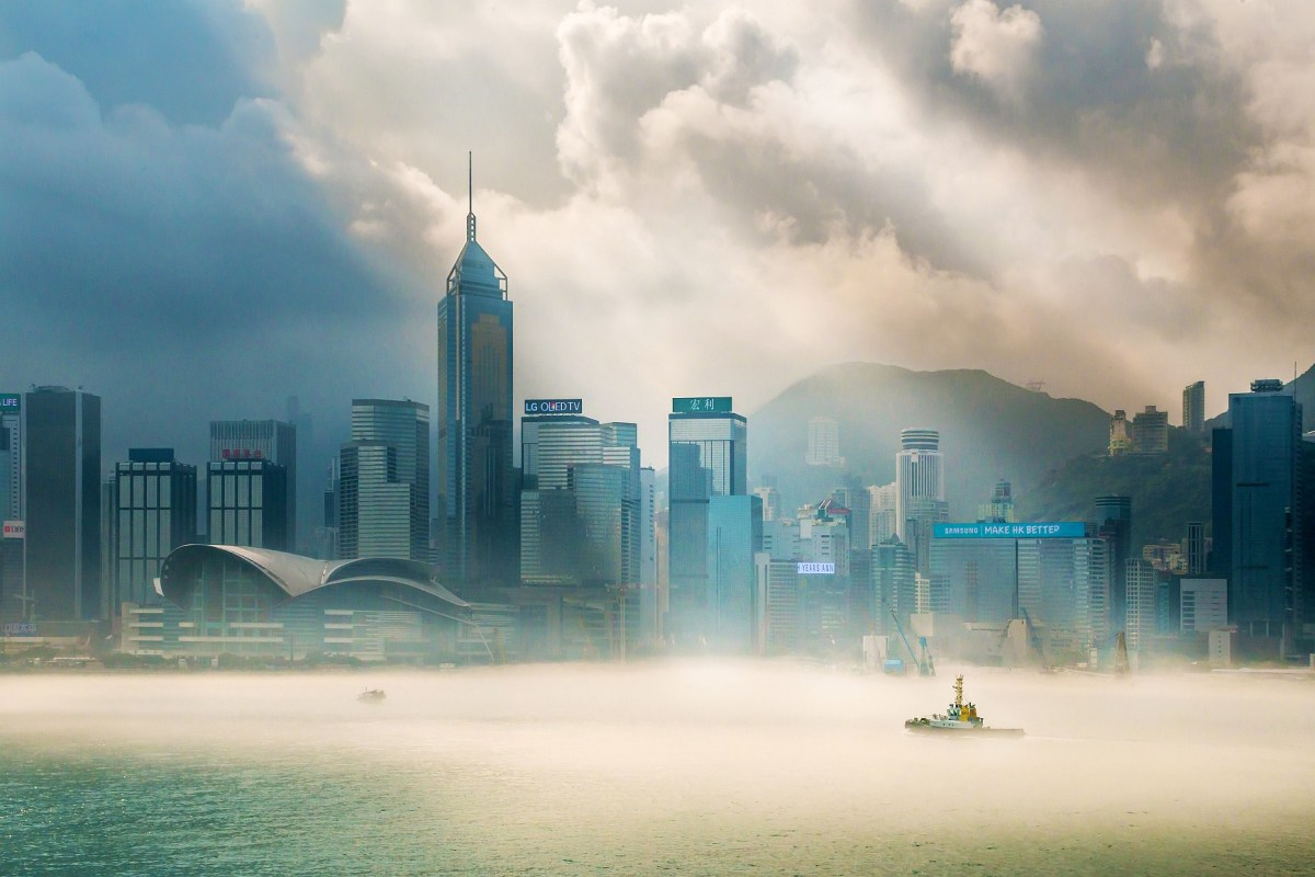 Skyscrapers in Hong Kong's Victoria Harbor are shrouded in wintery mist. Photo: Facebook