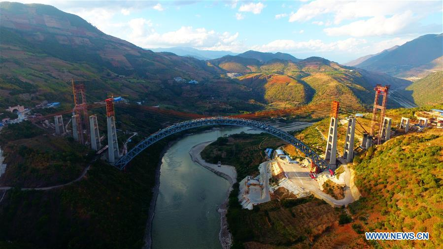 An aerial view of the arched bridge under construction, whose span is the largest of its kind in the world. Photo: Xinhua