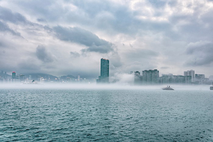 Hong Kong's Victoria Harbor is blanketed in wintery mist. Photo: Facebook