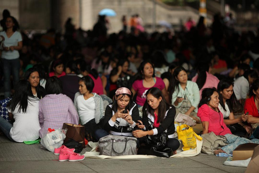 A file photo shows foreign domestic helpers gathering beneath the HSBC building in the Central district of Hong Kong. Photo: AFP