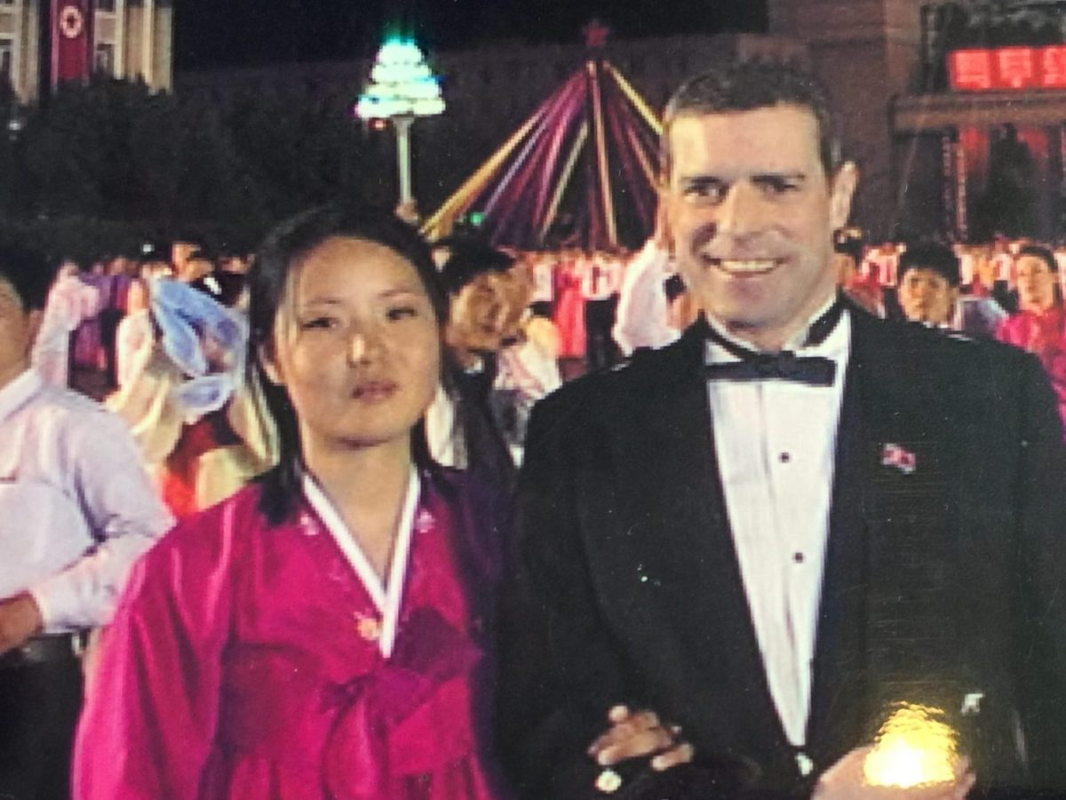 Mike Hay with a local companion, in festive mood in downtown Pyongyang.  While Hay says relationships with North Koreans were a joy, locals are legally prohibited from marrying foreigners. Photo: Mike Hay