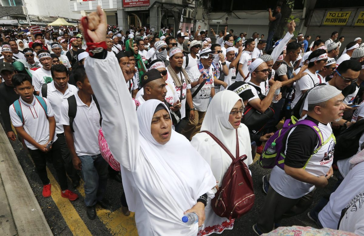 Demonstrators march during the rally to celebrate the government's decision not to ratify the United Nations International Convention on The Elimination of All Forms of Racial Discrimination (ICERD) organized by several pro-Muslim-Malays NGOs at Independence Square, Kuala Lumpur, Malaysia, December 8, 2018. Photo: AFP Forum via EyePress Newswire/FL Wong