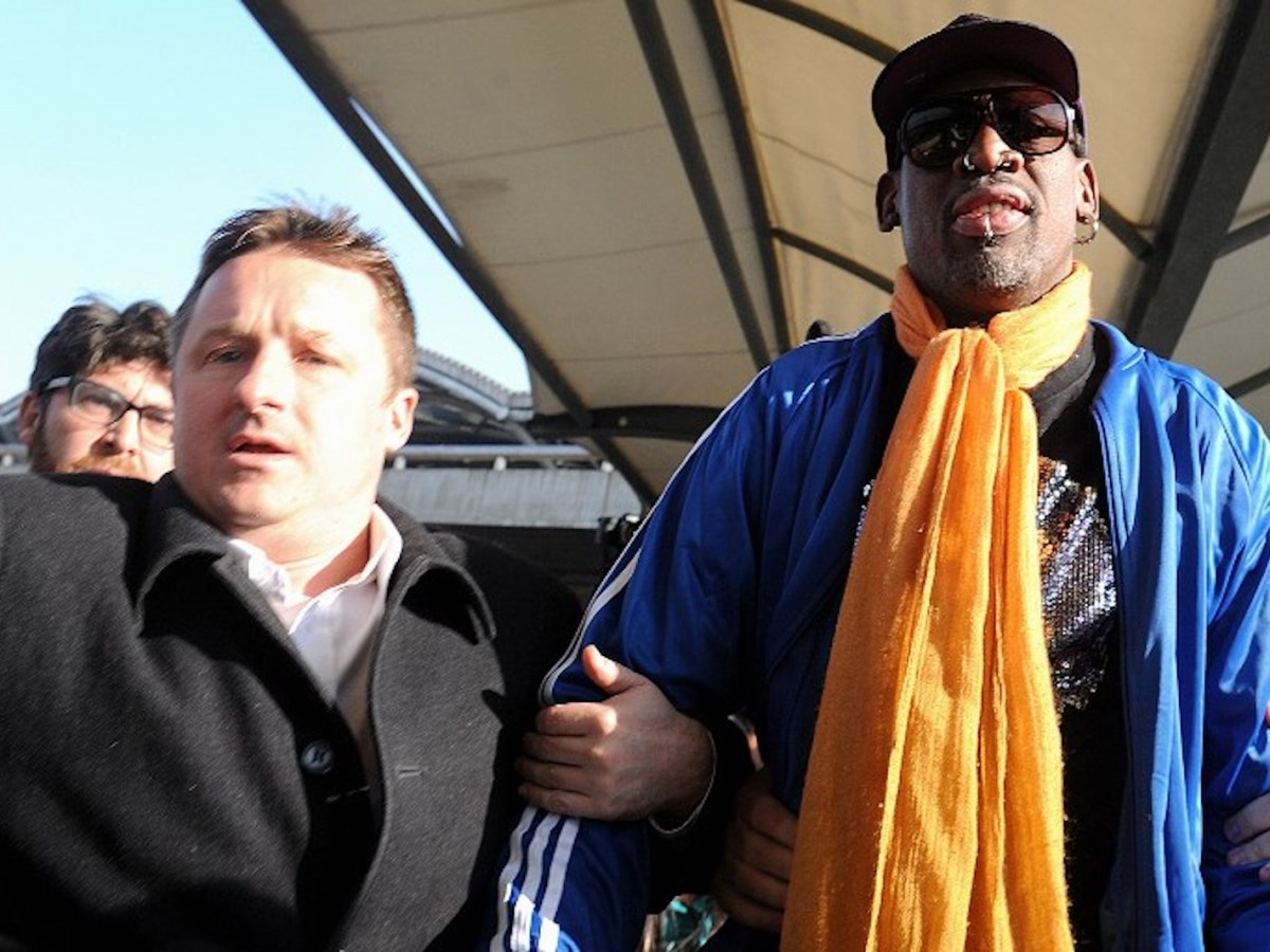 Michael Spavor, left, and the former US basketball star, Dennis Rodman, arrive at Beijing International Airport from North Korea in 2014. Photo: AFP / Wang Zhao