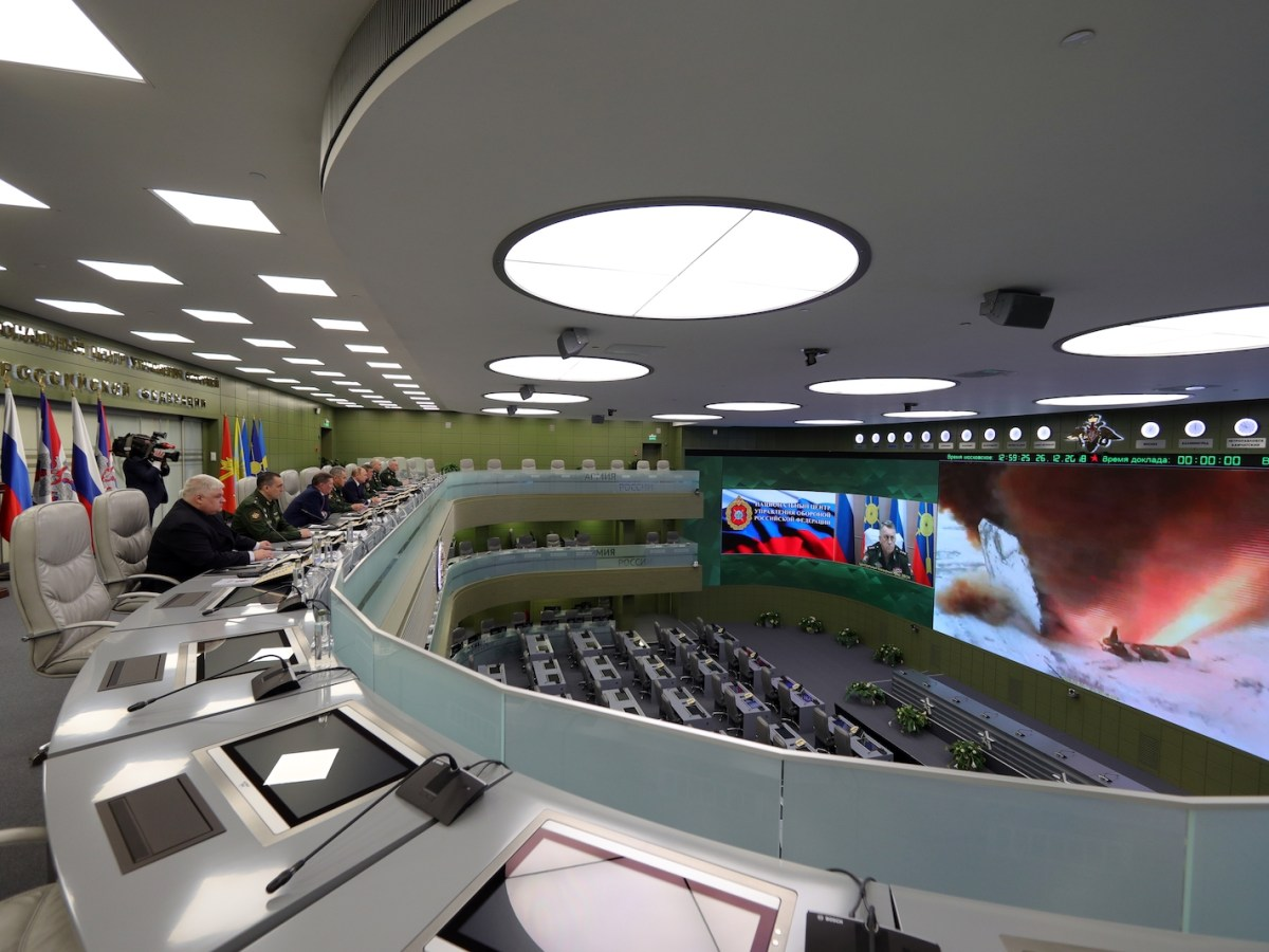 Russian President Vladimir Putin watches the launch of the Avangard hypersonic missile at the National Defense Control Center via a video conference. Photo: Mikhael Klimentyev / Sputnik / AFP