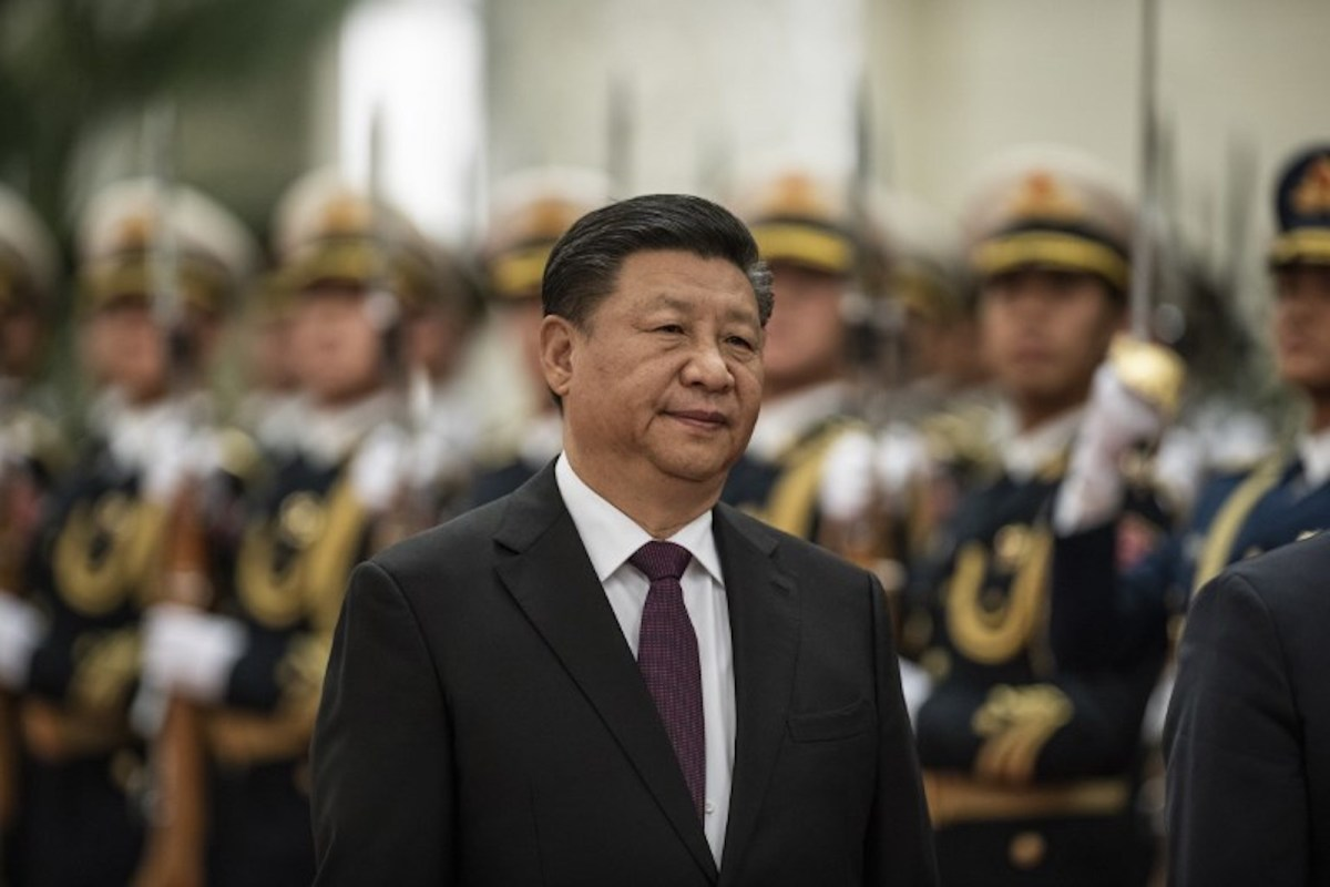 China's President Xi Jinping reviews a military honor guard outside the Great Hall of the People in Beijing on December 10, 2018. Photo: AFP / Fred Dufour
