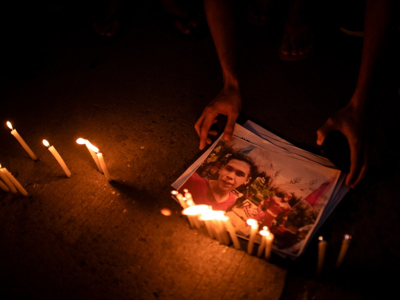Supporters of Kian delos Santos attend a vigil last week at the police station where three police involved in Kian's killing were assigned in Manila. The three police received long jail terms on Nov 29 for murdering the teenager. It was the first conviction of officers carrying out President Duterte's war on drugs. Photo: Noel Celis / AFP