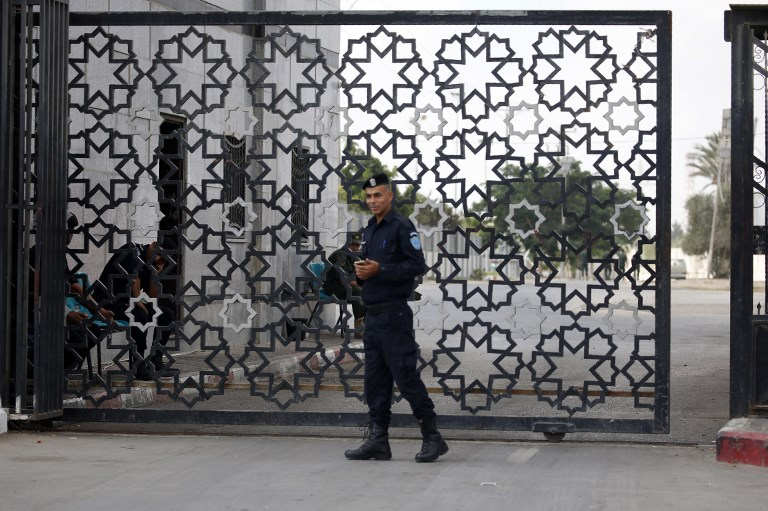 A member of the Palestinian security forces stands guard at the Rafah border crossing with Egypt in the southern Gaza Strip on September 26. Photo: AFP