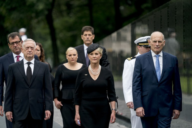 Donald Trump's chief of staff John Kelly (right) and Defense Secretary Jim Mattis (left), seen with John McCain's wife, Cindy, at the late senator's funeral. Photo: CNP