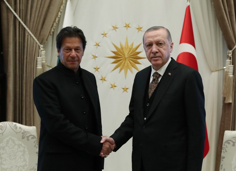 Turkish President Recep Tayyip Erdogan (R) shakes hands with Pakistani Prime Minister Imran Khan (L) as they pose for a photo ahead of their meeting at the Presidential Complex in Ankara, Turkey on January 04, 2019. Turkish Presidency / Kayhan Ozer / Handout / Anadolu Agency