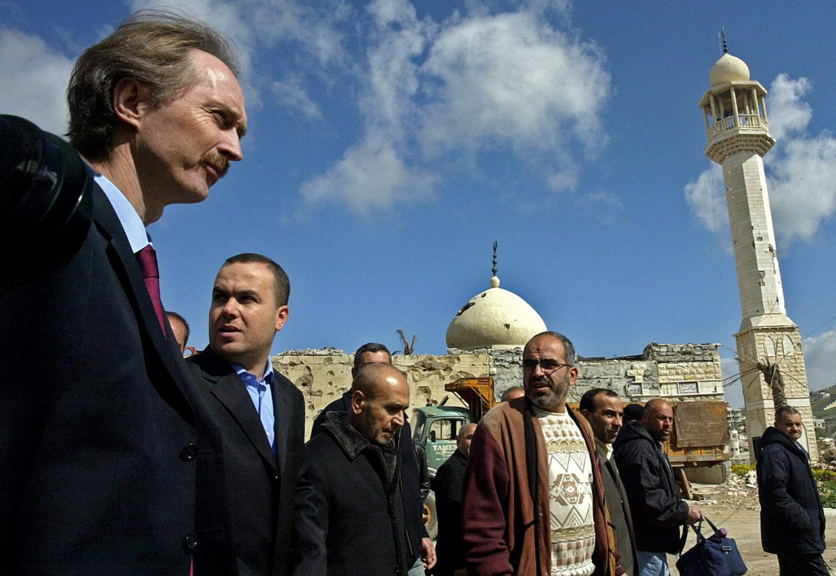Geir Pedersen, left, when he was UN coordinator for Lebanon, walks past a damaged mosque during a tour of the devastated town of Bint Jbeil in Lebanon with Hezbollah deputy Hassan Fadlallah, second left, in March 2007. Pedersen now has the post of UN envoy for Syria. Photo: AFP / Mahmoud Zayat