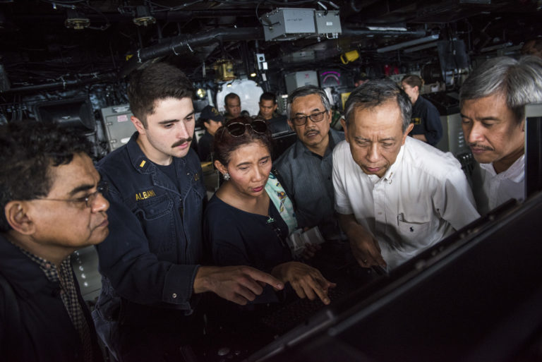 Susi Pudjiastuti, center, Indonesia's Fisheries Minister, takes a tour of the USS New Orleans (LPD 18) during the ship's recent visit to Bali. Photo: US Navy / Flickr.