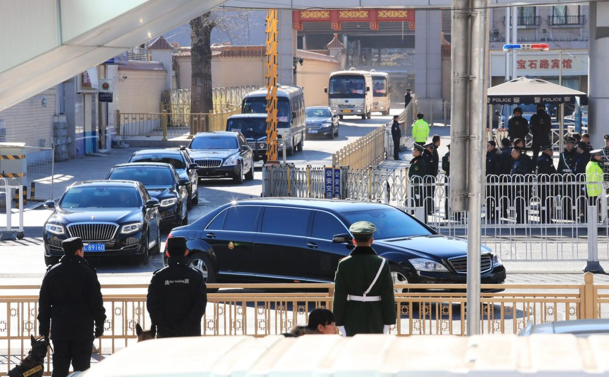 A motorcade thought to be carrying North Korean leader Kim Jong Un leaves Beijing railway station on Tuesday morning. Photo: AFP/The Yomiuri Shimbun