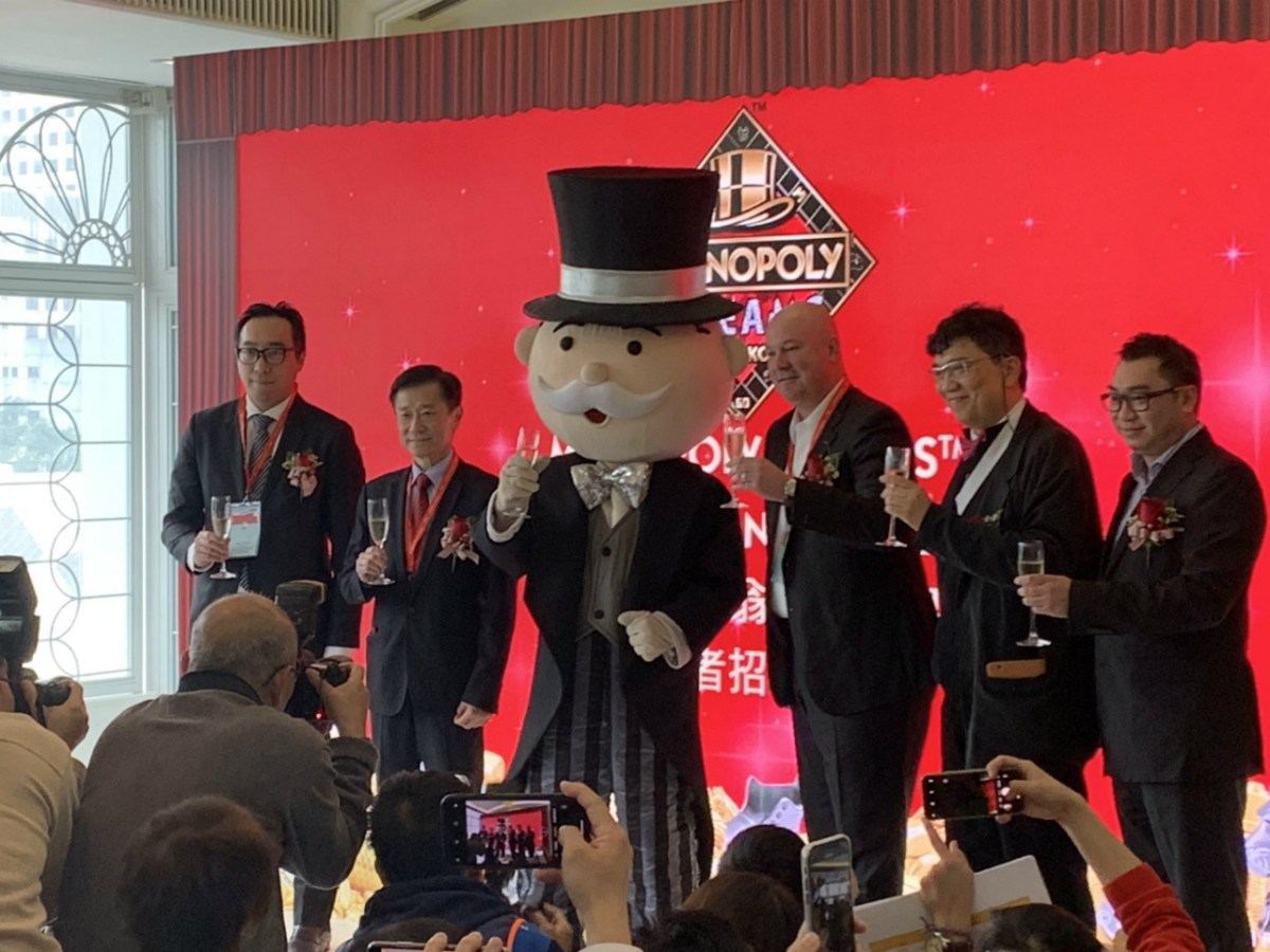 Executives launch the Monopoly-themed attraction, which will open later this year. Photo: Asia Times