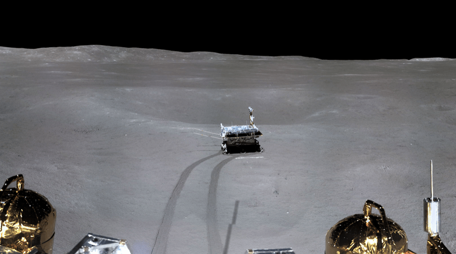 The Yutu rover cruising on the surface of the moon's dark side, leaving two tracks behind it. Photo: Handout