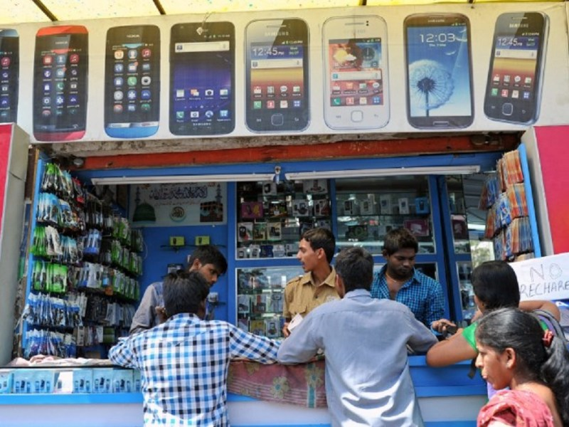 Customers at a mobile phone shop in Hyderabad. Photo: AFP
