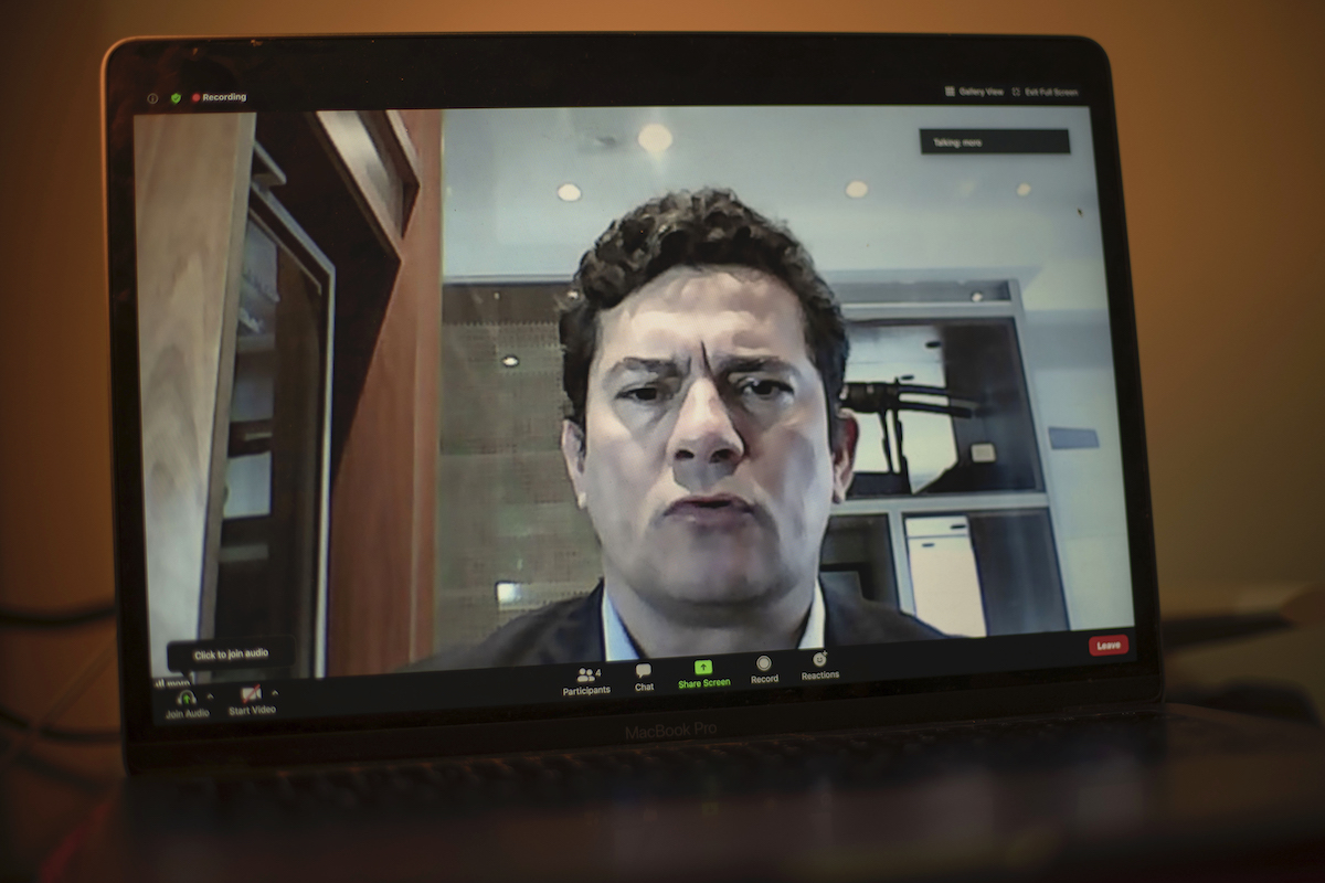 >Former Brazilian minister of justice and public security Sergio Moro is seen on a laptop's screen as he speaks during a video interview with AFP from Curitiba, Parana state, Brazil, on July 6. Photo: AFP / Mauro Pimentel