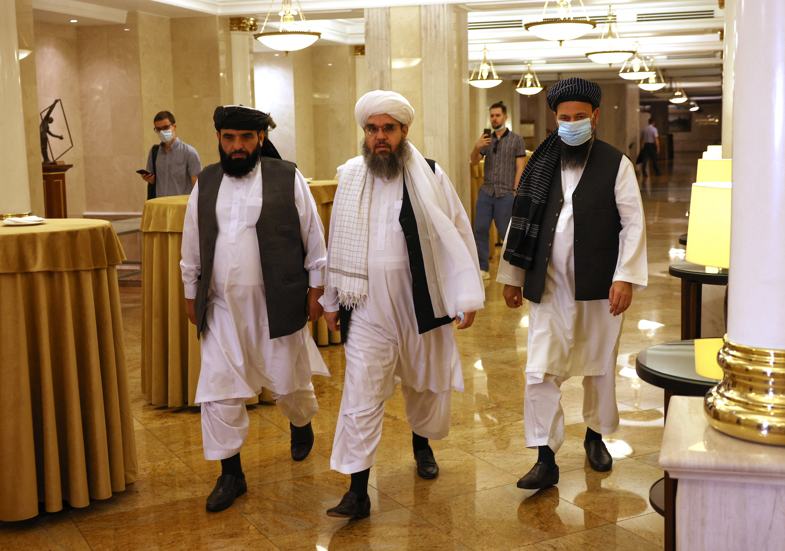 Taliban negotiators Abdul Latif Mansoor (right), Shahabuddin Delawar (center) and Suhail Shaheen (left) walk to attend a press conference in Moscow on July 9, 2021. Photo: AFP / Dimitar Dilkoff