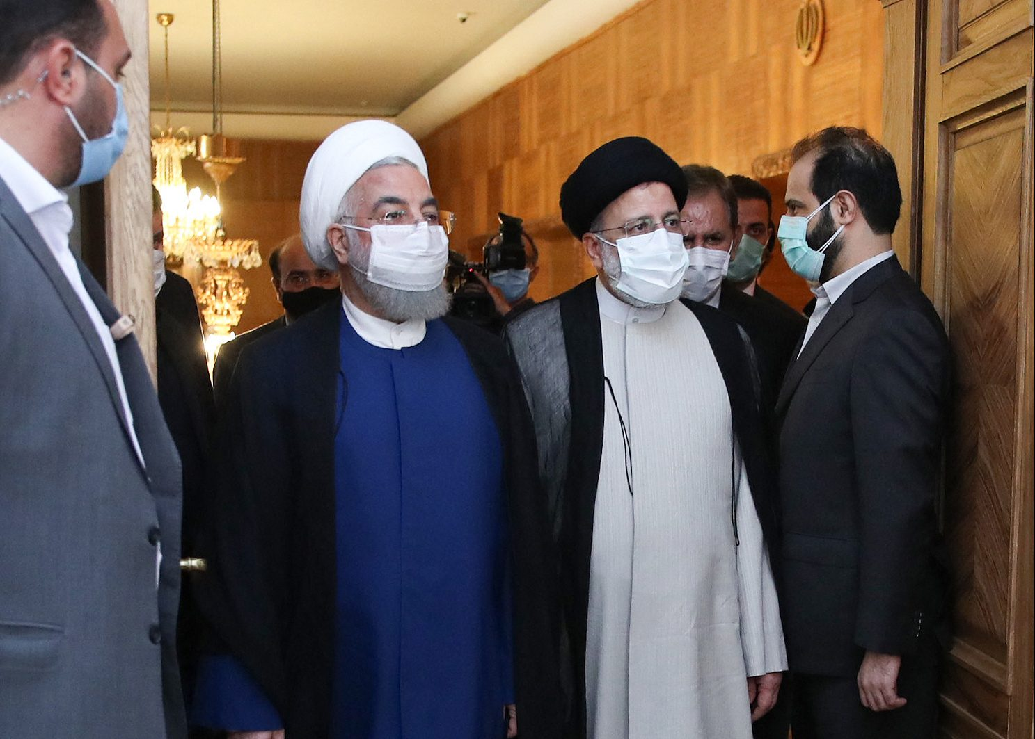 Outgoing president Hassan Rouhani (L) and Iran's newly inaugurated President Ebrahim Raisi arriving for the handover ceremony in Tehran, August 3, 2021. -Photo: AFP / Iranian Presidency
