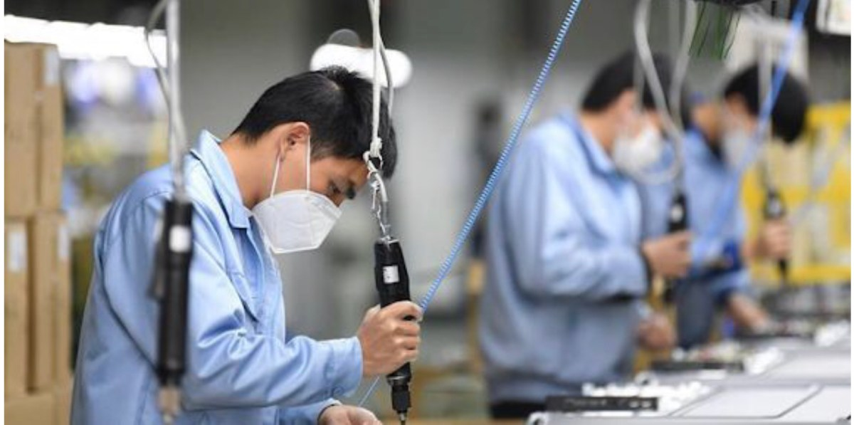 China's economy wobbles as Covid starts to hit production