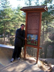 What To Do In Bhutan - See Bhutan National Animal - Takin, Timotheus with folklore signage