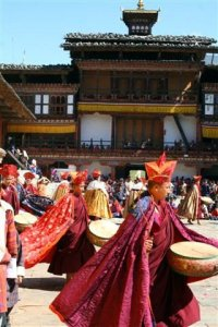 Monks dance and perform with drums at festival at Tashichho Dzong