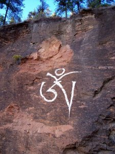Huge Om Sign painted on side of one of the slopes of Radio Tower Hill