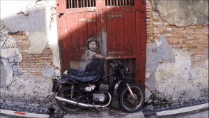 One of the famous Street Art in Penang - Boy On Motorcycle