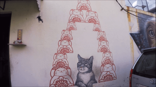 One of the famous Street Art in Penang - Love Me Like Your Fortune Cat