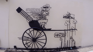 One of the Wrought Iron Artworks - the humorous Trishaw