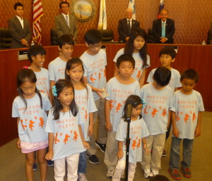 Coral Springs Chinese School students singing Taiwan ROC National Anthem to full house at Sunny Isles Beach sister city ceremony in Commissioners Chambers