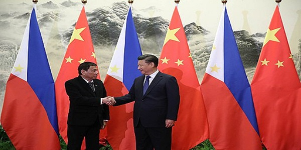 CHINA-BEIJING, MANILA FLY THE FLAG FOR PEACEFUL WATERS