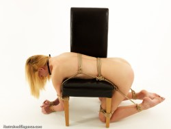 Ariel Anderssen bound and gagged bent over a leather chair