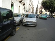 Sicilians take double parking to an art form and. An easily block up a six lane city thorofare with such a tangle of dumpsters parking and stopped trucks that a city bus can't get down it.