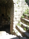A turning stair case cuts through the huge retaining wall/fortification.