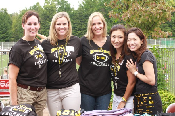 Boosters selling ASIJ spirit wear