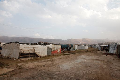 An 'informal tented settlement' in Lebanon's Bekaa valley. The mountains in the background form the border with Syria, just a few miles away.