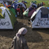 View of a makeshift camp near the village of Idomeni on the Greek - FYR of Macedonia border where thousands of refugees, mainly from Iraq and Syria, are stranded after a decision by states along the Western Balkan route to Northern Europe to introduce quotas on the number of people they allow entry through their borders on a daily basis. ; More than 24,000 refugees are trapped in Greece as the Western Balkan route to Northern Europe mostly shuts down. The FYR of Macedonia border crossing is now only open to a few hundred Syrians and Iraqis per day, creating a backlog at the unofficial border crossing of Idomeni as well as the port of Piraeus in Athens. Only those with passports or official ID cards may cross. Afghans are barred completely. It's the latest in a series of restrictions imposed by Austria and a group of Western Balkan countries over the past few months aimed at stemming the migrant flows toward Germany, the destination of choice for most people. Text: Tania Karas/UNHCR
