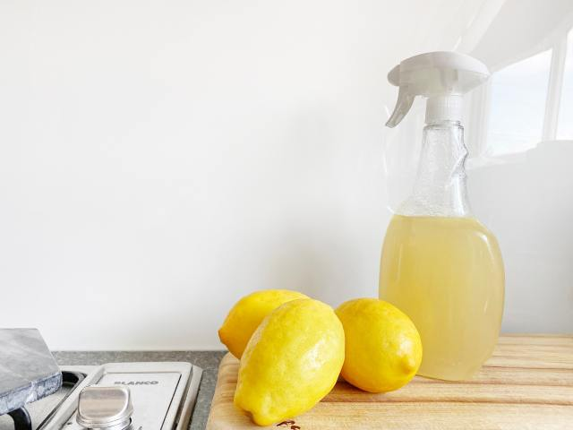 lemons and a spray bottle of yellow liquid