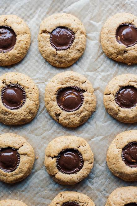 Peanut butter cup cookies laid out on parchment paper.