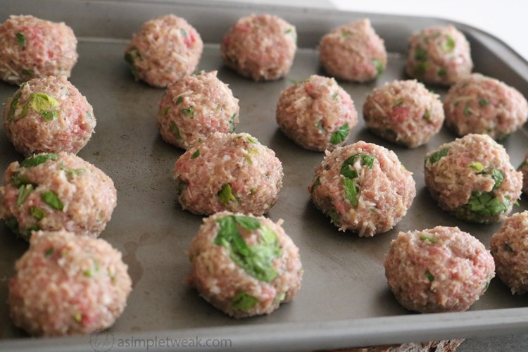 Lastly, using a tablespoon or a small cookie scoop (depending on the desired size) scoop some of the meat mixtures and rolled them between your hands to make them a uniform size just like the image below!