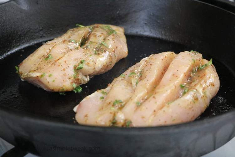 Lightly grease a cast iron or oven/stovetop safe pan and heat over a medium-high temperature. Place the chicken breast on the cast iron. Meanwhile, proceed to pre-heat the oven to 350-degree Fahrenheit.